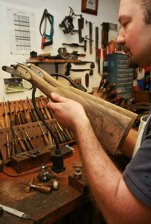 Checking the shape on a pair of bespoke made stocks.