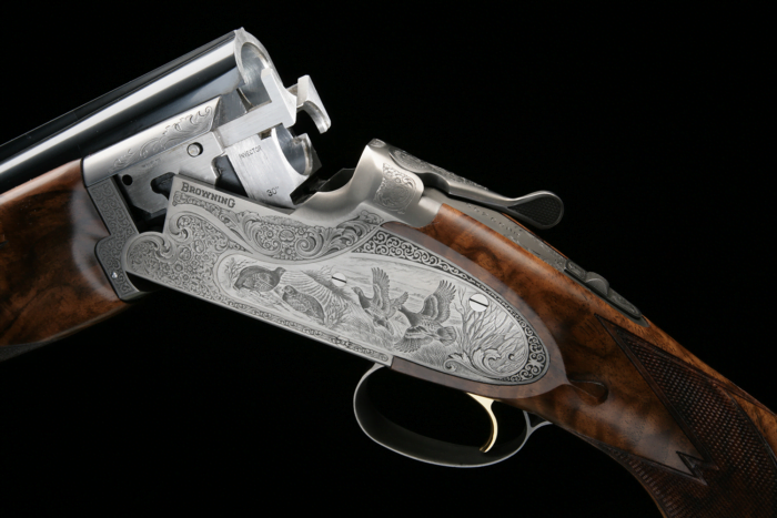A Browning shotgun with custom engraving.